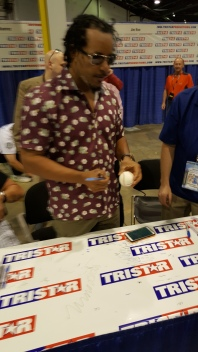 Manny signing ball